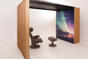 Wooden shop in shop stand and information platform with LED backlit lightbox
