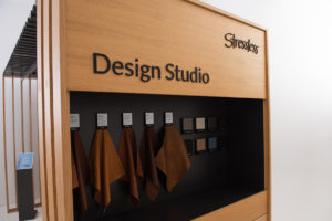 Wooden shop in shop focus center with information platform